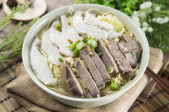 Chinese bowl of wanton noodle with beef anf pork on the table in Stock Image
