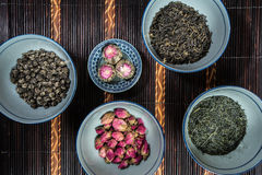 Chinese Bowls filled with different kinds of Tea. Decorated stock photography