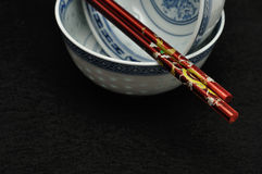 Chinese bowls with a pair of chopsticks Stock Photography