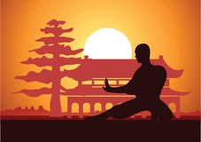Chinese Boxing Kung Fu martial art famous sport,monk Train to fight,around with Chinese temple. Sunset silhouette design Royalty Free Stock Photography