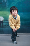 Chinese boy. Street-side billboards in front of a little boy Royalty Free Stock Photos