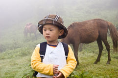 Chinese boy. Early morning fog,Racecourse Chinese children Royalty Free Stock Image
