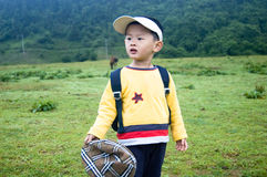 Chinese boy. The sun has just come out,Children standing in pasture Stock Photo
