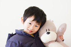 Chinese boy. I and toys are good friends Royalty Free Stock Images