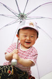 Chinese boy. This is my son,he very like his umbrella Royalty Free Stock Photo
