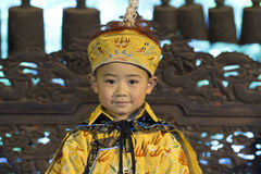Chinese boy as Emperor. Little chinese boy dressed as Chinese Emperor Royalty Free Stock Photography