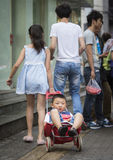 Chinese boy in a cart Stock Photo
