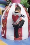 Chinese boy climbing Stock Image
