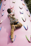Chinese boy climbing Royalty Free Stock Photography