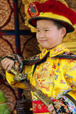 Chinese boy dressed as Emperor with a sword Stock Photo