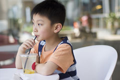 Chinese boy drinking Royalty Free Stock Image
