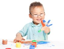 Chinese boy painting with hands Stock Image
