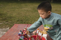 Chinese boy painting Stock Photo
