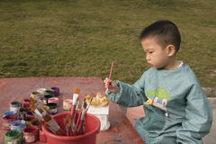 Chinese boy painting Royalty Free Stock Images