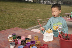 Chinese boy painting Royalty Free Stock Photos