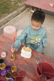 Chinese boy painting Stock Image