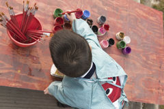 Chinese boy painting Royalty Free Stock Photo