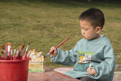 Chinese boy painting Stock Images