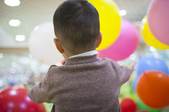 Chinese boy playing balloon in playground Royalty Free Stock Photo