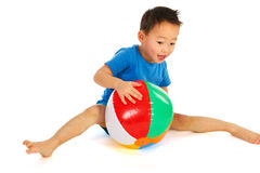 Chinese boy playing with beach ball Royalty Free Stock Photography