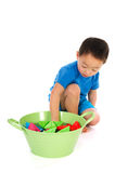 Chinese boy playing with paper boats Stock Photography