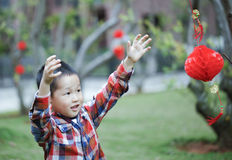 Chinese boy playing red lantern Royalty Free Stock Images