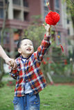 Chinese boy playing red lantern Stock Images