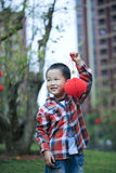 Chinese boy playing red lantern Stock Image