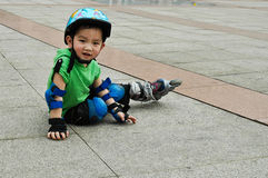 Chinese boy playing skate Royalty Free Stock Images