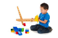 Chinese boy playing with toys Stock Image