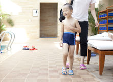 Chinese boy preparing swiming. At pool Stock Images
