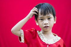 Chinese boy in red traditional Stock Image