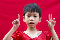 Chinese boy in red traditional Royalty Free Stock Photo