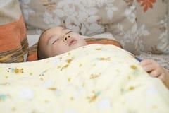 Chinese boy sleeping Stock Photo