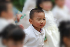 The Chinese boy on stage Royalty Free Stock Photos