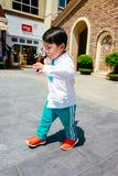 Chinese boy on the street in school uniform. Happy chinese kid join out door activity on the street stock images