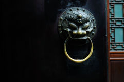Chinese brazen door knocker. A brass knocker in Chinese traditional style on the door leaf of a gate,at Chengdu,China Royalty Free Stock Photos