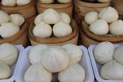 Chinese breads for sale. Chinese breads also called `Baozi` for sale  at Wangfujin `Food Street`, Wangfujin, Beijing, China Stock Photos