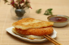 Chinese breakfast. Fried glutinous rice cake and tea Stock Photography