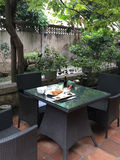 Chinese breakfast on a table in a hotel courtyard in Xiamen city, China Royalty Free Stock Photos