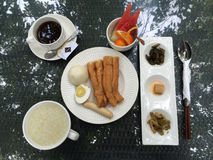 Chinese breakfast on a table in a hotel garden in Xiamen city, China Royalty Free Stock Images