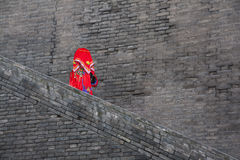 Chinese bride on an ancient city wall Stock Photography