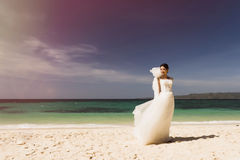 Chinese bride on the beach. Royalty Free Stock Photo
