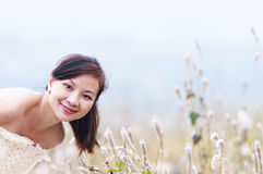 Chinese  bride on a field Stock Photo