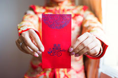 Chinese bride giving red pocket lucky money. In the wedding Stock Images