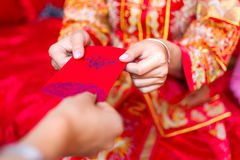 Chinese bride giving red pocket lucky money stock photos