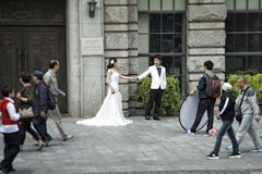 Chinese bride and groom on the street Royalty Free Stock Photo