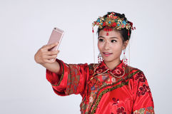 Chinese Bride taking a selfie.  stock photography