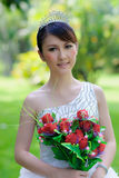Chinese bride with wedding dress Stock Images