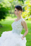 Chinese bride with wedding dress Stock Photography